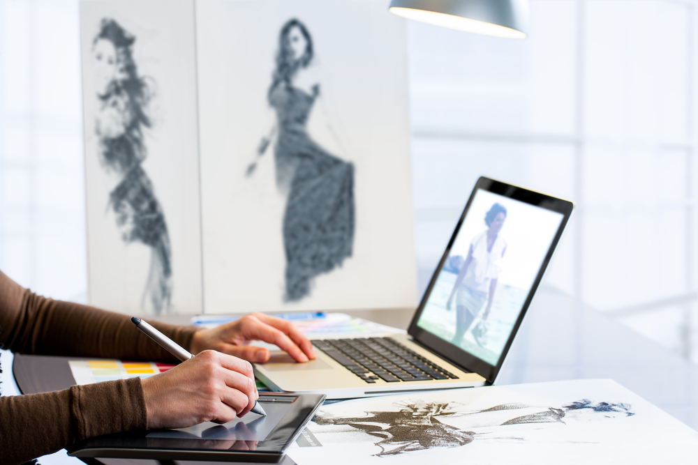 Fashion designer working on a digital illustration.
